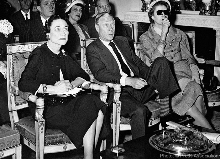 June 1953: The Duke and Duchess of Windsor watch the coronation of Queen Elizabeth II on the television screen at the Paris home of the American socialite Mrs. Margaret Biddle (right),