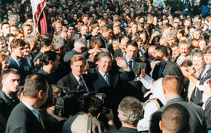 Crown Prince Alexander is greeted by crowds in the Serbian capital, Belgrade. (Above) Crown Prince Alexander and family during the ceremony at Claridges Hotel, London, in which HRH's Yugoslav citizenship was restored.