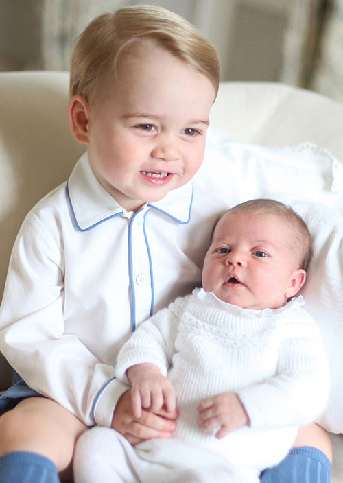 (Above and top) Princess Charlotte and Prince George of Cambridge in portraits  taken by  the Duchess of Cambridge.