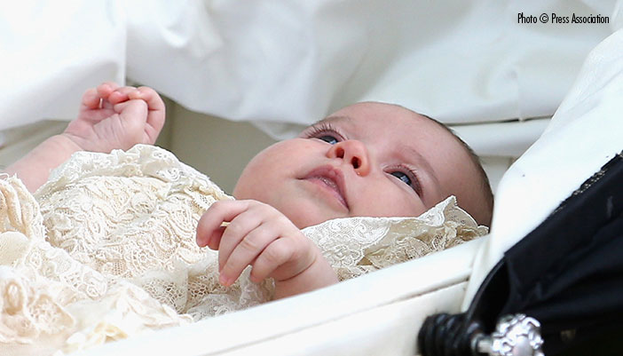 Princess Charlotte photographed after her christening ceremony at St. Mary Magdalene church. (Above) The Duke and Duchess of Cambridge. William picks up Prince George and Kate takes baby Princess Charlotte to her christening.