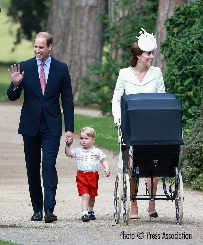 The Duke and Duchess of Cambridge with Prince George and Princess Charlotte, in the pram once used by her great grandmother Queen Elizabeth II.