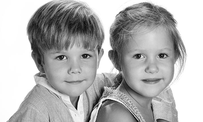 (Above) A portrait released by the Crown Prince Couple for Prince Vincent and Princess Josephine's sixth birthdays. (Top) The twins attend a Christmas concert with the Royal Family.