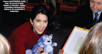 Crown Princess Mary introduces 'Buddy Bear', the mascot of 'Better Buddies', to Denmark's children at Bumblebee kindergarten in Hellerup in the municipality of Copenhagen.
